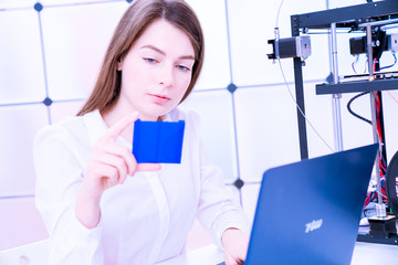 Young women designer in 3d printing lab