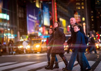 Family crossing Broadway in Times Square, New York City