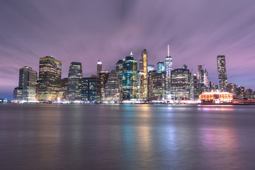 View on Financial District from East River at night with long exposure