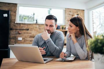Couple managing finances.
