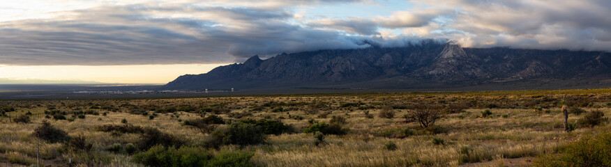 Beautiful Panoramic American Landscape during a cloudy sunrise. Taken North of El Paso, New Mexico, United States.