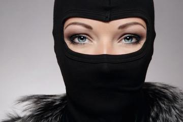 Beautiful woman in black biker's balaclava - fototapety na wymiar