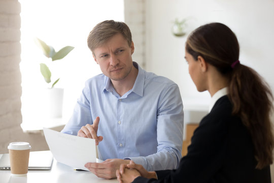 Doubting hr manager having questions for applicant at job interview, recruiter read bad resume, looking with suspicion, dishonest job seeker, boss dissatisfied employee work results, contract fraud