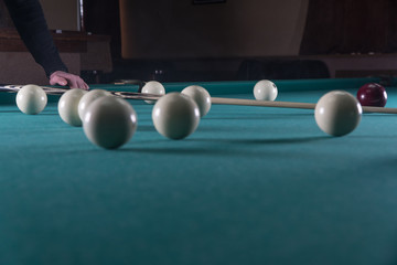 play billiards. cue and billiard balls. hammer the ball into the hole.