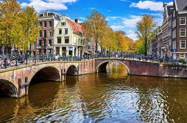 Fototapete - Bridges on the channel in Amsterdam, Netherlands. Traditional
