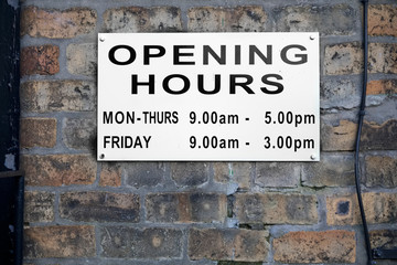 Opening hours shop sign Monday to Friday daytime