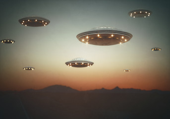 Invasion of alien spaceships under the sky at sunset. Old style film photography image.
