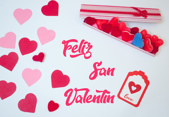 San Valentine´s day  decoration made withabox with heart jelly beans gummies and red and pink paper hearts. Lover gift.