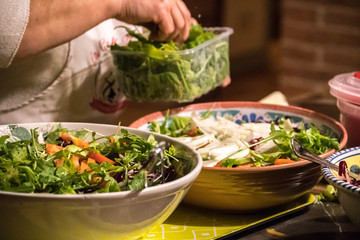 Entertain with the best gourmet foods. Cut bread, cheese, slices meats, arugula salad, meal prep...