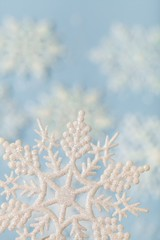 Artificial Snowflake With More Snowflakes In Background Close-up