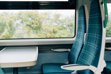 Empty seats with a tray on a train