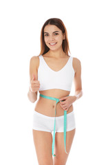 Slim woman measuring her waist on white background. Weight loss