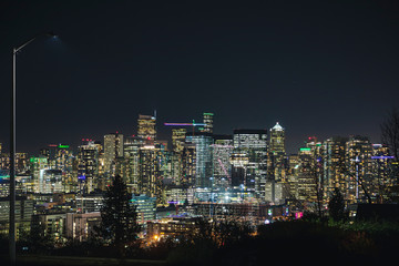 Night Photography Street View of Bright Seattle Skyline Lights.