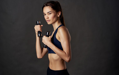 woman with fitness dumbbells