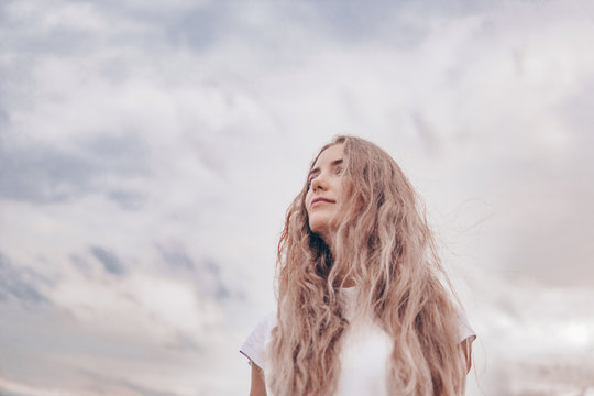 feminism and beauty. the struggle for gender equality . A white woman against a background of sky and clouds. Women force rights self-confident concept.
