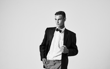 young business man in black suit