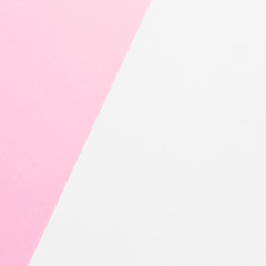 White and pink background. Flat lay. Top view. Colorful texture