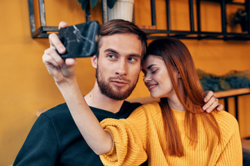 young couple selfie cafe