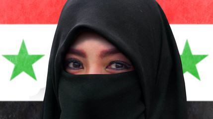close up face portrait of beautiful Muslim woman in traditional Islam burqa or burka head scarf posing cheerful and happy smiling isolated on Syria flag background
