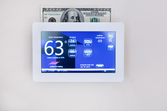 digital thermostat technology to heat or cool home for energy savings concept
