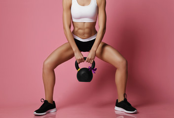 New spring sport workout concept for woman day 8 march. Girl working out with big weight dumbbell  Wall mural