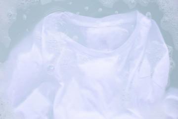 Soak cloth before washing, white t-shirt