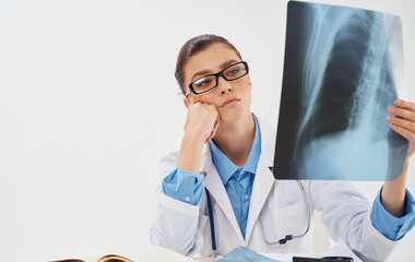 doctor looks at x-ray on white background bruises fractures medicine