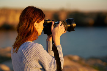 woman photographing sunset sea nature