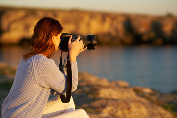 woman photographs nature of the river