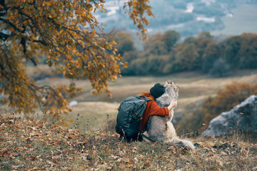 woman hugging a dog nature