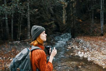woman photographs nature hike mountains autumn trip