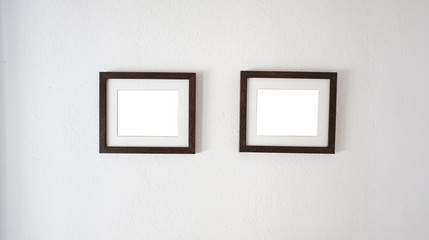 Empty white frame on a wall for mock up