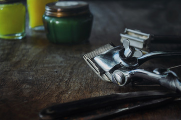 Vintage barber shop tools on wooden table