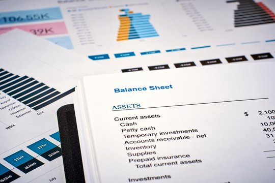 balance sheet on the background of financial documents, close-up