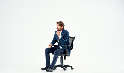 business man sitting on a chair on a white background