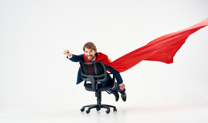 business man hero riding a chair on white isolated background