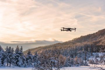 Flying drone like Mavic 2 Pro.