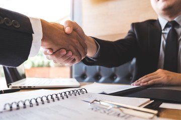 Successful job interview with boss and employee shaking hands after negotiation or interview, career and placement concept