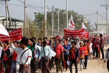 Workers protest in front of Shyang Jhuo Yue Co., Ltd, a Taiwanese owned sports shoe manufacturer after the sudden factory shut down left 700 without work, in Yangon