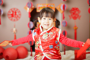 Chinese baby girl  traditional dressing up with a FU means lucky red envelope