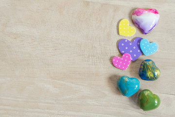 Valentine, love and wedding concept background. Colorful heart on wood table with free copy space. Vintage and retro. Picture for add text message. Backdrop for design art work.