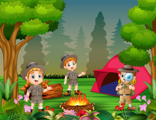 Happy children camping out in the beauful forest