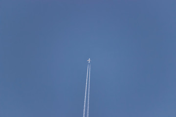 Commercial Airplane flying in a blue sky