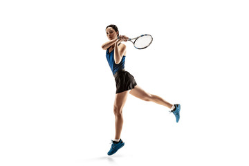 Fototapeta Full length portrait of young woman playing tennis isolated on white background. Healthy lifestyle. The practicing, fitness, sport, exercise concept. The female model in motion or movement obraz