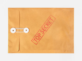 Fototapeta Stamp top secret on the brown envelop file ,isolated on white background obraz