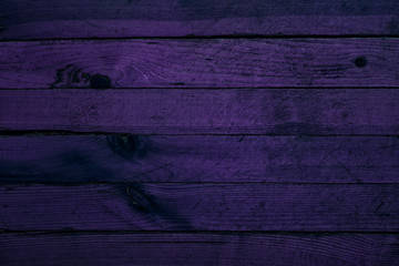 mysterious purple texture of wooden boards with natural patterns close-up