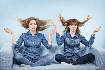 Two shocked women with windblown hair
