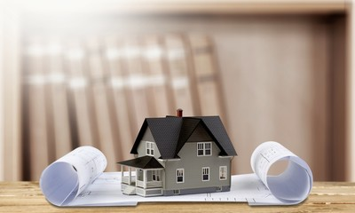 Classic house model on blueprint on white background