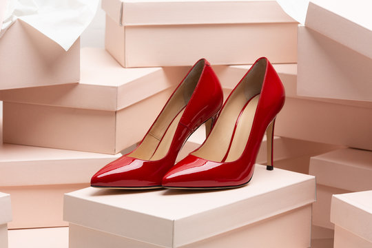 New red leather high heel shoes on the box