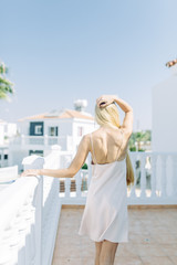 Bright morning bride in a Villa in Cyprus. Beautiful girl in a white boudoir dress.
